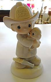 precious moments samuel butcher love rescued figurines
