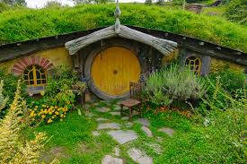 real hobbit house hobbit house with yellow door editorial stock image image of
