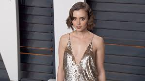 lily collins reveals new fairytale inspired tattoo in gown at