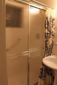 hanging curtains over sliding glass door hide ugly shower doors bathroom pinterest shower doors