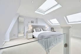dormer room plain wooden workdesk pure wrinkled bed