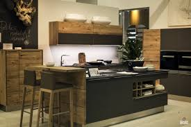 gray island with black soild surface countertop natural wooden