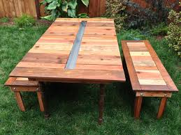 outdoor backyard picnic table with ice cooler box in the middle