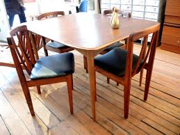 1960s walnut dining set inabstracto