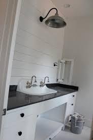 gooseneck lighting for over a vanity or in a bathroom barnlight