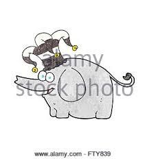 freehand retro cartoon elephant wearing circus hat stock vector