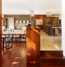 split level entry living room contemporary with wood dining table