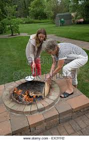 Cooking Over Fire Pit Grill - cooking over log fire stock photos u0026 cooking over log fire stock