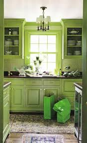 green kitchen island mediterranean kitchen style illuminated with recessed lighting and