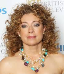 medium haircut for curly hair curly thick medium haircuts alex kingston medium length curly hair