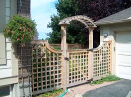 victorian trellis cedar fence with gate and arched gate brace