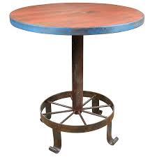 Wagon Wheel Coffee Table by Wagon Wheel Bar Table With 4 Painted Wood Bar Stools