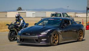 nissan gtr vs kawasaki h2r drag races bugatti veyron nissan gt r rideapart