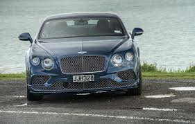 black and gold bentley bentley continenetal gt speed goes from gentle giant to high