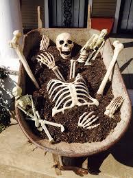 Halloween Decorations Skeleton Bones by Creepy Skeleton Bones In Our Wheel Barrel Outside Halloween
