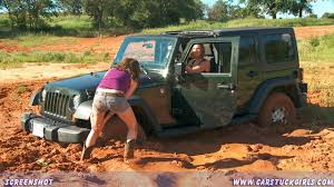 girls jeep wrangler two girls stuck in mud with their jeep and their boots