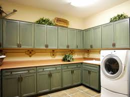 Laundry Room Storage Between Washer And Dryer by Home Design Ideas Interesting Design Laundry Room Cabinets Ideas