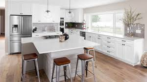 white shaker kitchen cabinets wood floors white shaker cabinets lakehouse remodel highcraft cabinets