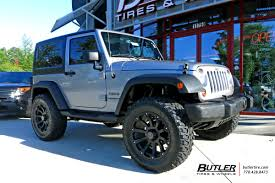 jeep blue and black jeep wrangler with 20in black rhino sidewinder wheels exclusively