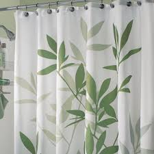 green fabric curtain with green leaves on stainless steel hook of