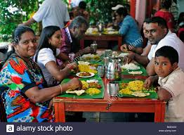 indian family lunch together india singapore stock