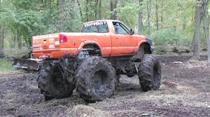 mudding trucks big orange 4x4 truck mudding at big als youtube