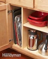 install cabinets like a pro the family handyman diy how to install a storage divider this small space stores and