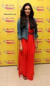 desai shows how to wear denim jacket with a maxi dress