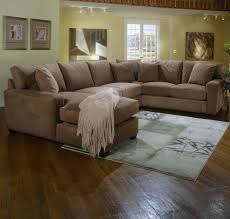 L Shaped Wooden Sofas Brown Sofa With Cushions Grey Carpet Also Wooden Laminate Flooring