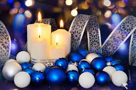 blue white christmas lights lighted candles and blue white christmas tree decorations on the
