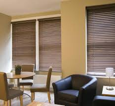 interior white wood venetian blinds with rectangle dining table
