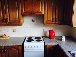 priced to sell solid wood kitchen cupboards units sink