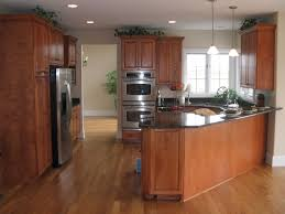wood cabinets with black granite counter tops angled peninsula