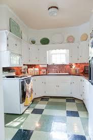 kitchen copper tile backsplash with decorative roaster also