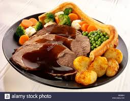 traditional roast beef dinner with pudding stock photo