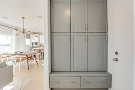 gray mudroom cabinets with bench transitional laundry room