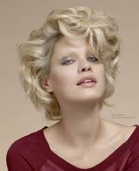 mid neck length 60s hairstyle with large curls