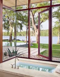 texas lakeside house has an exterior of wood limestone and glass