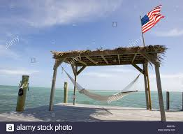 American Flag Hammock Empty Hammock Beneath Hut With American Flag In Islamorada