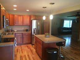 contemporary kitchen with raised panel u0026 hardwood floors in