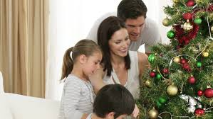 Christmas Tree Decorations And Their Meanings by Footage In High Definition Of Family Decorating A Christmas Tree