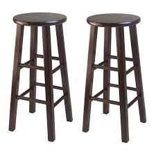 round dark brown polished wooden bar stool with four wooden base