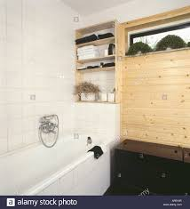 Bathroom With Shelves by Shelves Above Bath In Seventies Bathroom With White Tiled Wall And