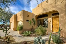 adobe style home for sale near numerous local golf courses