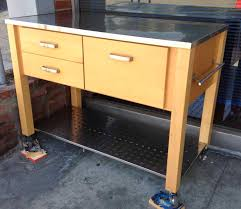kitchen island stainless top light oak wooden kitchen island on wheels having three drawers and