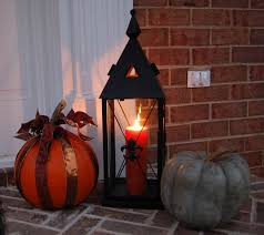 small decorate house for halloween with pumpkins and black metal