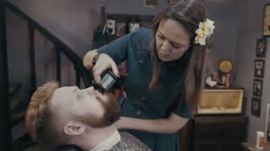 female haircutting videos clipper barber woman trimming beard of client with clipper at barbershop