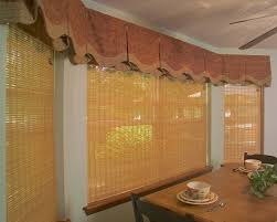 a scalloped inverted box pleat valance with contrast banding and