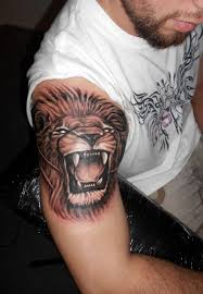 roaring lion tattoo on muscles in 2017 real photo pictures