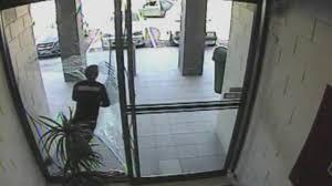 glass door wall amazing cctv bag thief smashes through glass door during escape